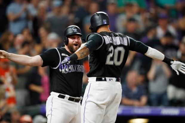 Colorado Rockies' Ian Desmond, right, celebrates ...