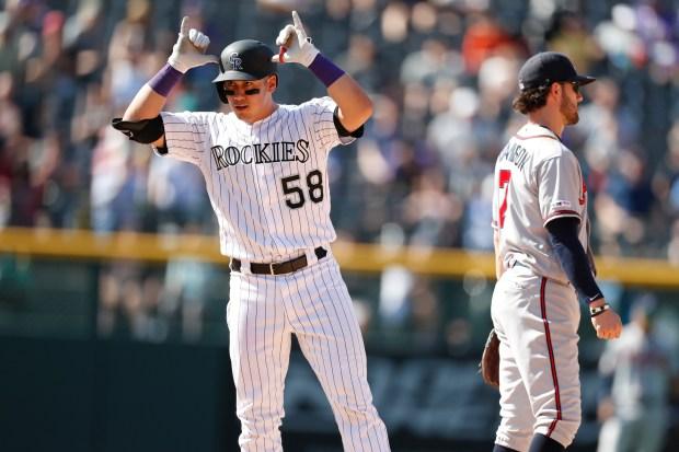 Colorado Rockies' Dom Nunez, left, gestures ...