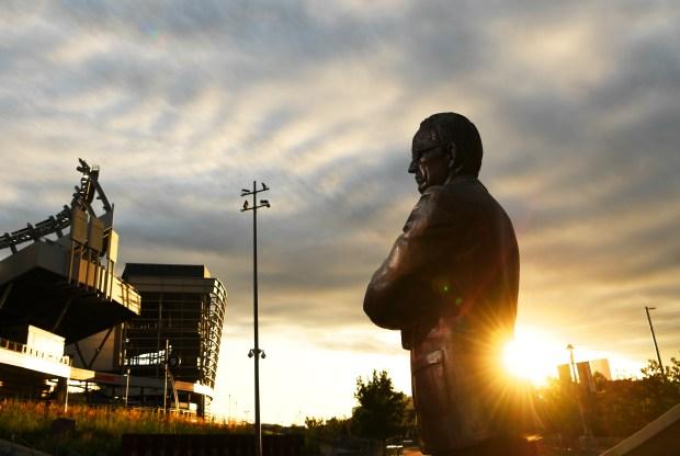 A statue of Pat Bowlen sits ...