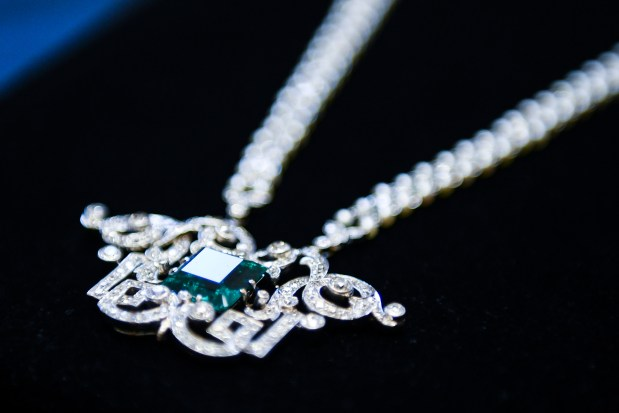 A Tiffany necklace sits outside of ...