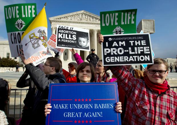 Anti-abortion activists protest outside of the ...