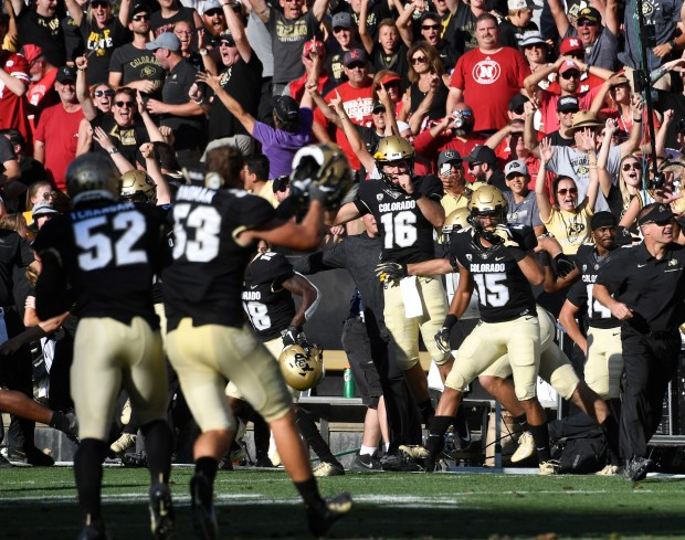 The University of Colorado sidelines erupt ...