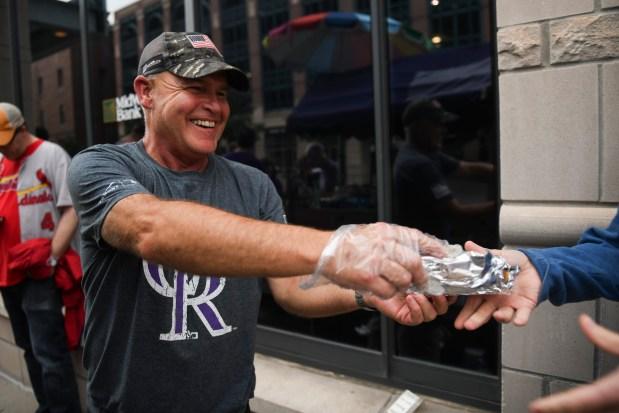 Joel Watkins sells hot dogs at ...