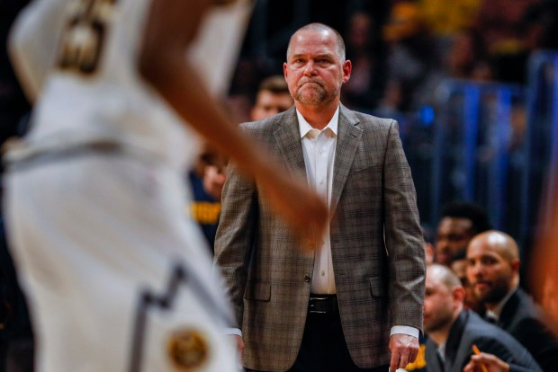 Denver Nuggets coach Michael Malone watches ...