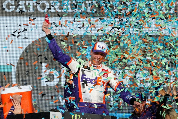 Denny Hamlin celebrates in Victory Lane ...