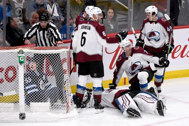 Colorado Avalanche teammates Erik Johnson (6), ...