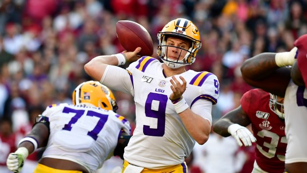 LSU quarterback Joe Burrow (9) throws ...