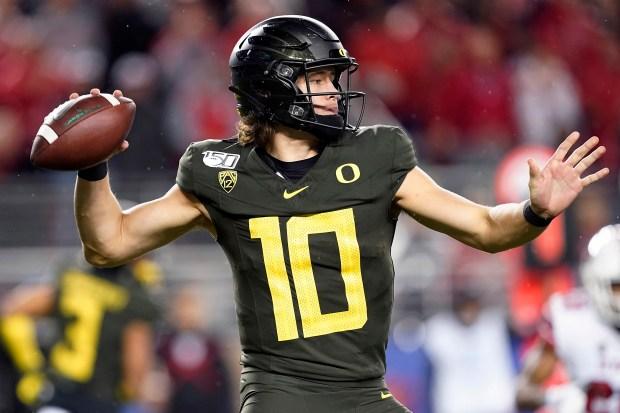 Oregon quarterback Justin Herbert throws a ...