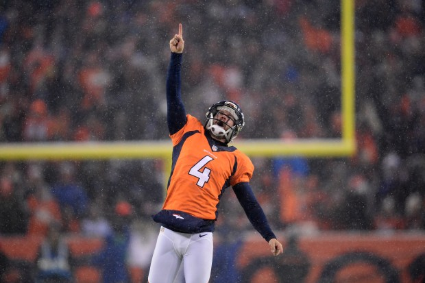Britton Colquitt (4) of the Denver ...