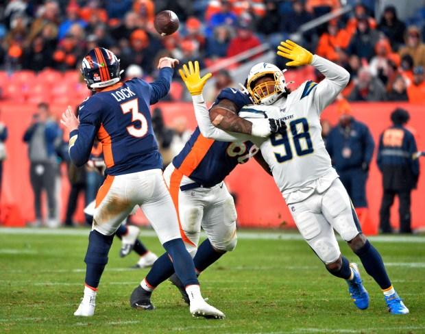 Denver Broncos quarterback Drew Lock (3) ...