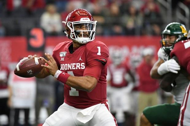 Oklahoma quarterback Jalen Hurts looks to ...