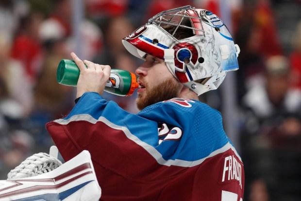 Colorado Avalanche goaltender Pavel Francouz drinks ...