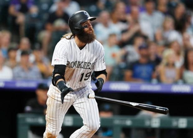 Colorado Rockies' Charlie Blackmon watches his ...