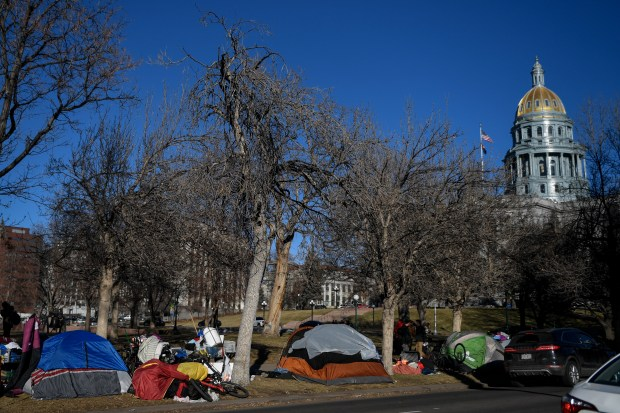 A homeless encampment of about a ...