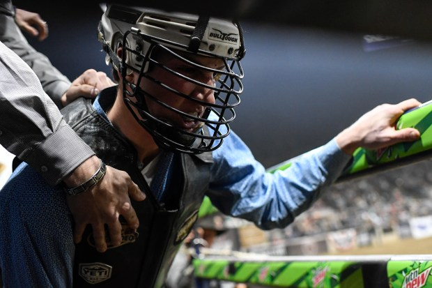 A rider prepares during PBR Denver ...