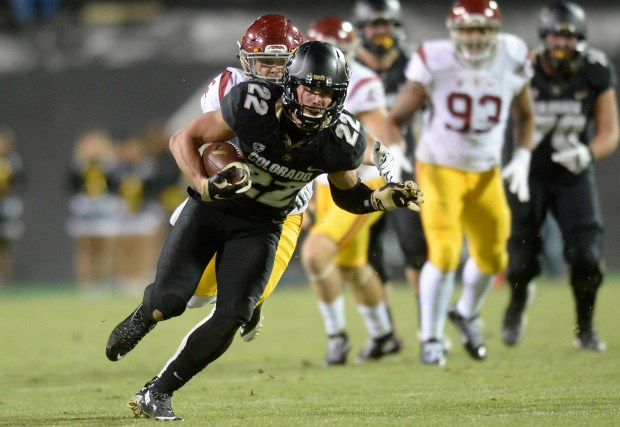 University of Colorado's Nelson Spruce runs ...