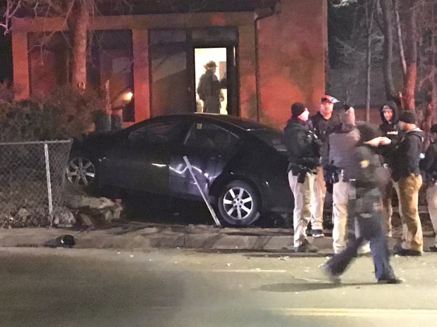 A car crashed onto property Feb. 18, 2020 on the southwest corner of Sheridan Boulevard and West 41st Avenue. Police say the driver was wanted in connection with a shooting earlier that day inside a Broomfield Walmart.