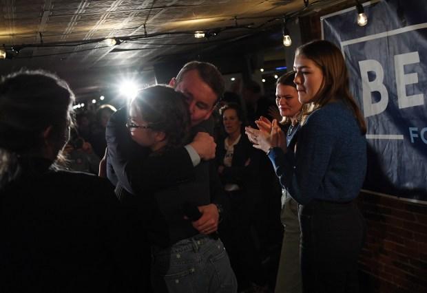 Democratic presidential candidate Michael Bennet hugs ...