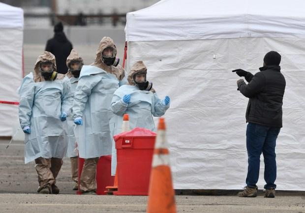 Colorado National Guard members assist the ...