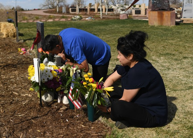 John Castillo kiss his son's grave ...