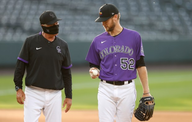 Colorado Rockies manager Bud Black, left, ...