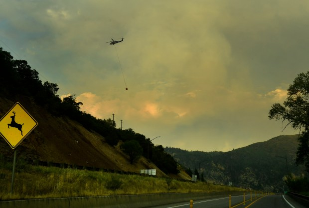 A helicopter works late into the ...