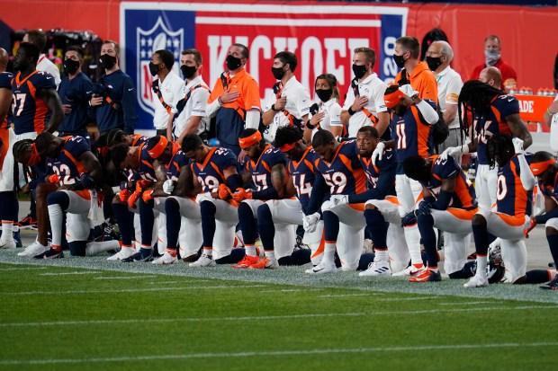 Some of the Denver Broncos kneel ...