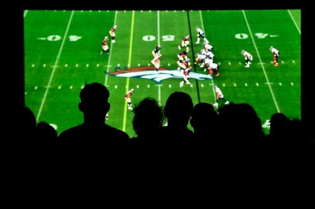 Denver Broncos fans watch the Denver ...