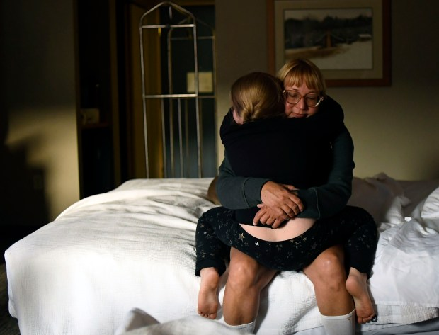 Brooke Dryden hugs Berkeley Hughes, 7, ...