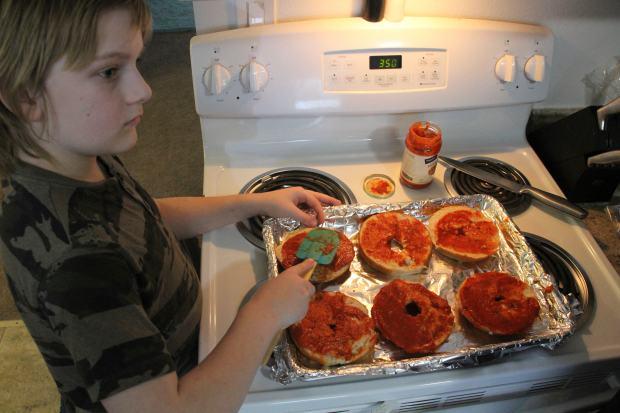 Jayden Messick, 9, helps his parents, ...
