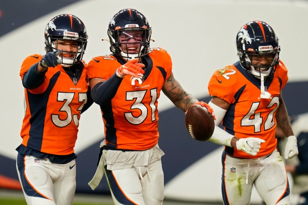 Denver Broncos safety Alijah Holder (33), ...