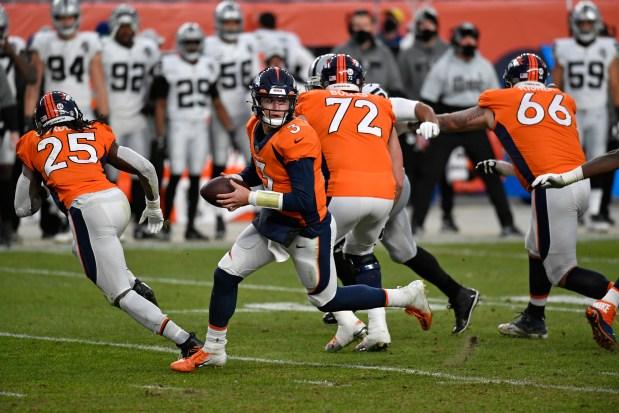 Denver Broncos quarterback Drew Lock, #3, ...