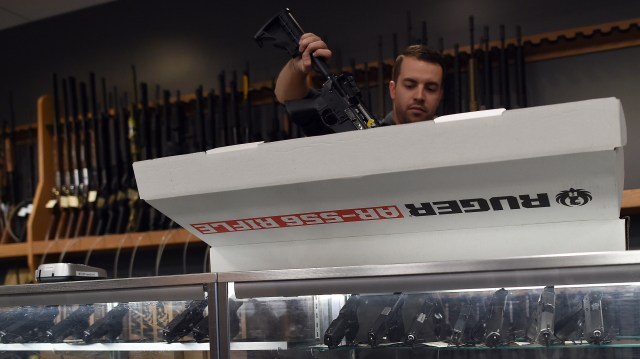 An employee un boxes a Ruger ...