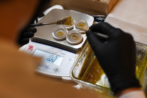 1g of marijuana concentrates are weighed ...