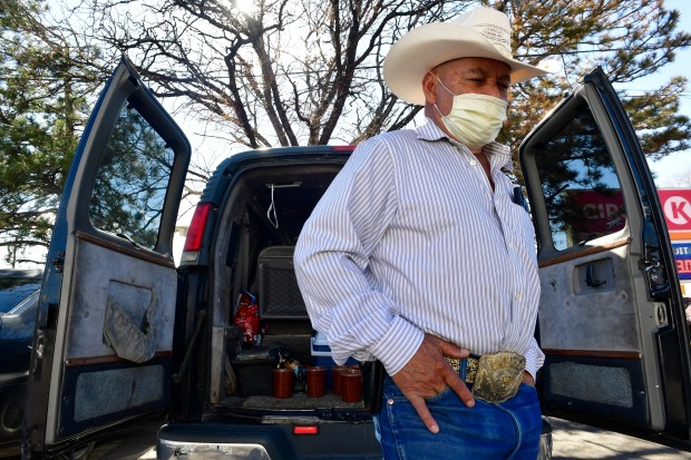 Alberto Ruvalcaba gets ready to head in to shop at the popular Carniceria La Pradera butcher shop and grocery store in Commerce City, Colorado