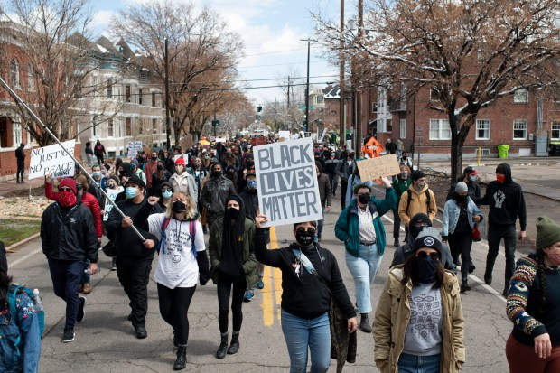 Protestors march in the street during ...