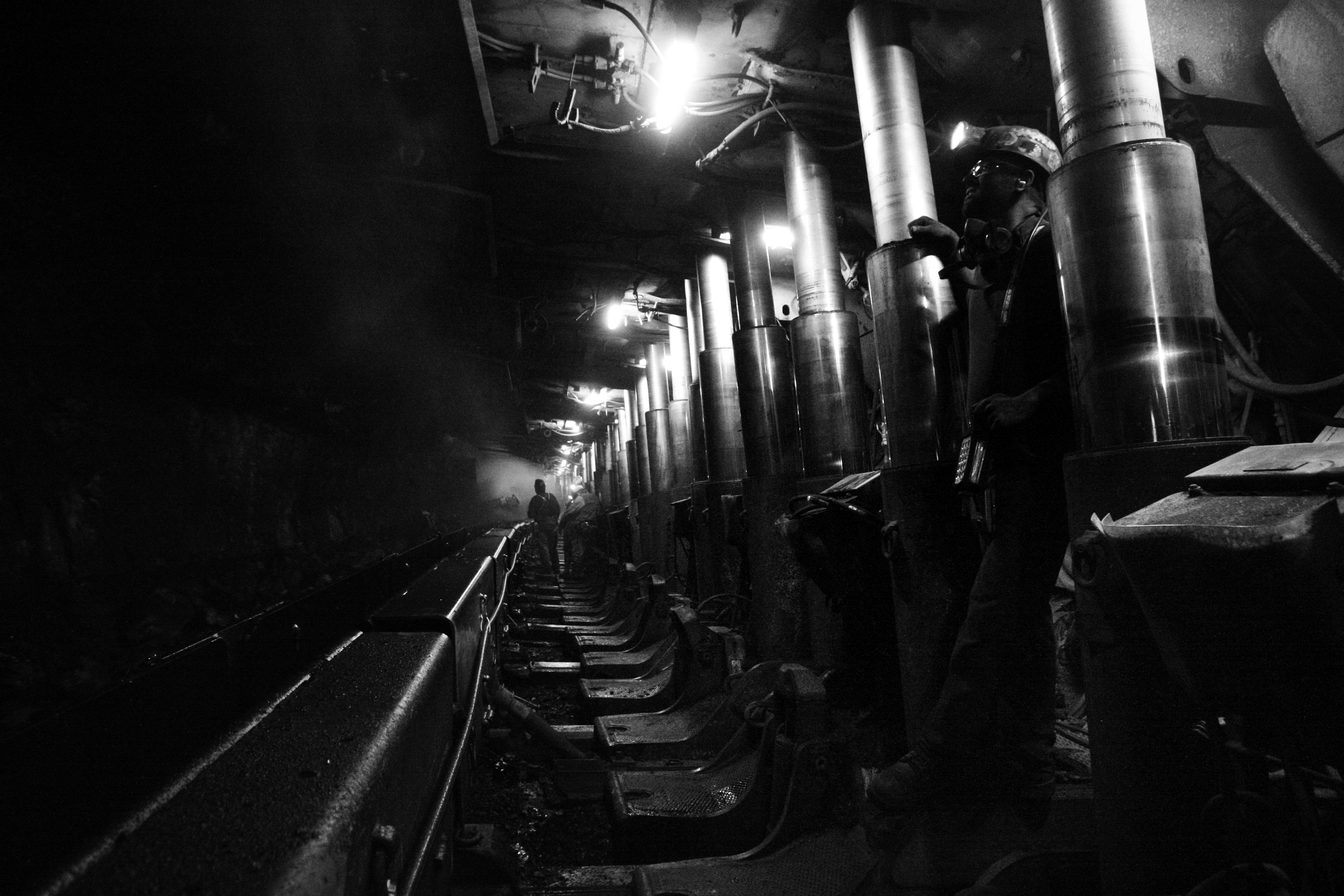 Coal miners work underground at the ...