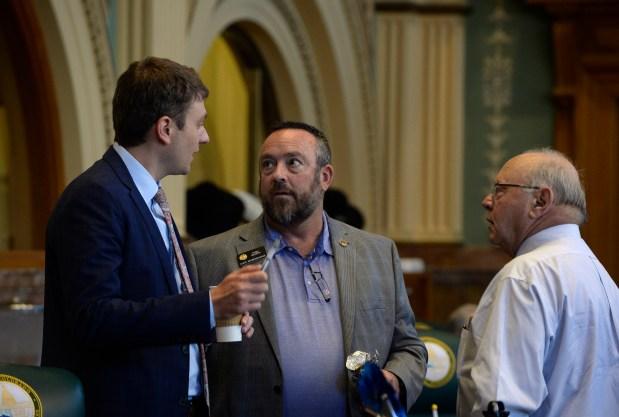 House Speaker Alec Garnett, left, meets ...