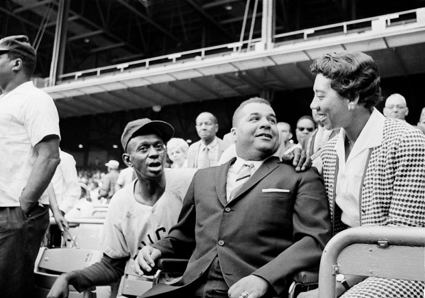 Roy Campanella, center, former major league catcher, chats with Althea Gibson, former tennis star and Satchel Paige at the Negro American League's 29th East-West All-Satr game at New York's Yankee Stadium, Aug. 20, 1961.