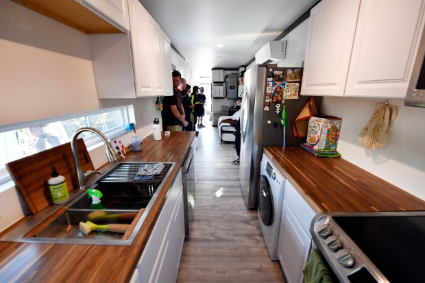 Potential buyers tour a model container ...