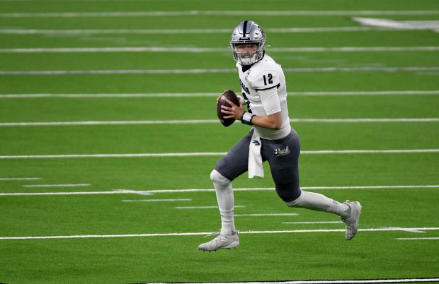 Quarterback Carson Strong #12 of the ...