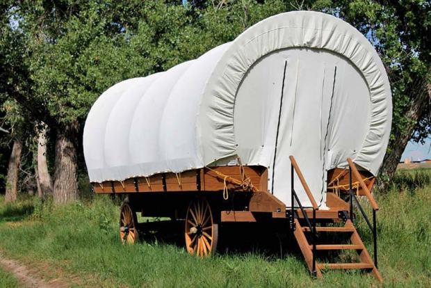 River Run at Granby provides covered wagons for sleeping, complete with bed and sitting area.