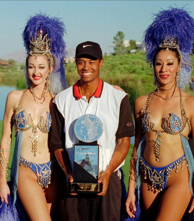 Tiger Woods, center, poses with ...