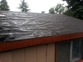 Can I roof over wet felt paper?