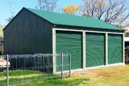 3 roller doors in gutter side shed, 3 car garage