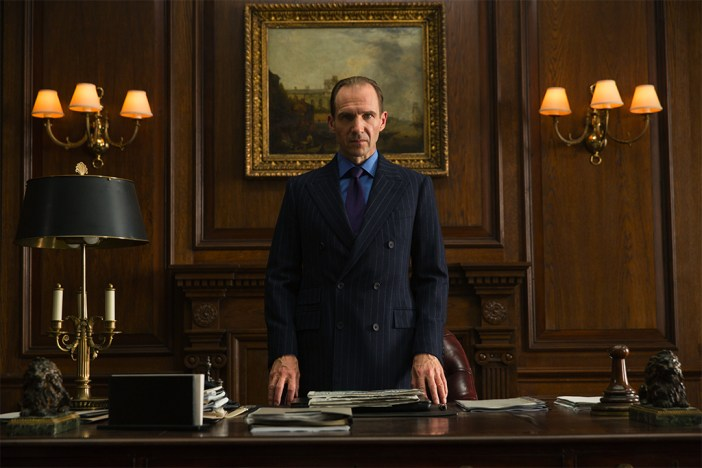 Ralph Fiennes as M in the movie Spectre. Under those immaculate double breasted suit's cuffs is the Longines Heritage Conquest.