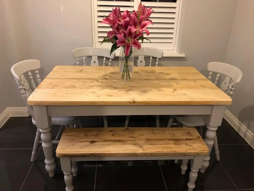 Dining table with painted grey legs and reclaimed wood antique pine top