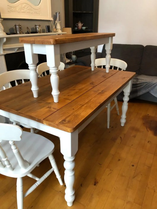 Dining room table with white painted legs and reclaimed wood table top