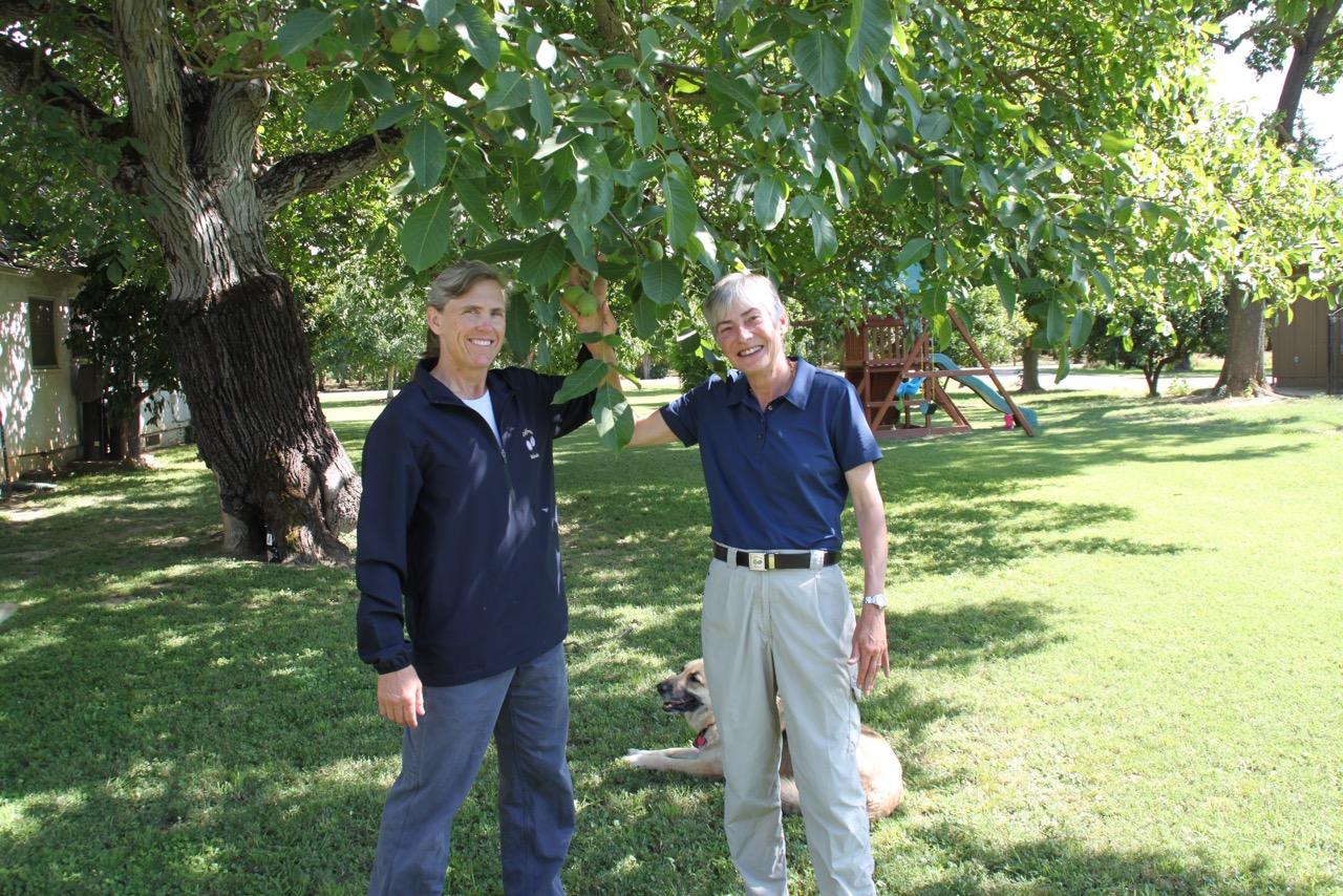 deann and pat showing walnut tree