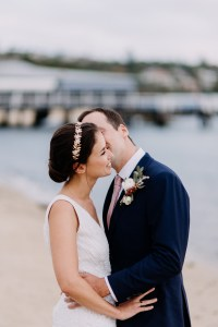 Bride and groom take a walk for photos at Watsons Bay